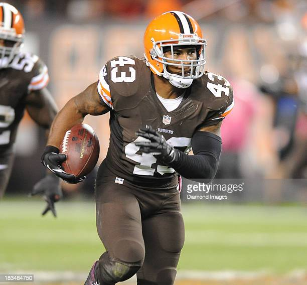 Defensive back TJ Ward of the Cleveland Browns sprints to the end zone to score a touchdown after a interception during a gams against the Buffalo...