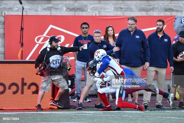 Defensive back Tommie Campbell of the Montreal Alouettes tackles wide receiver Diontae Spencer of the Ottawa Redblacks during the CFL game at...