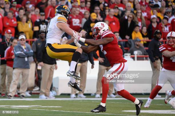 Defensive back Tony Butler of the Nebraska Cornhuskers runs into punter Colten Rastetter of the Iowa Hawkeyes at Memorial Stadium on November 24 2017...