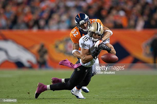 Defensive back Tony Carter of the Denver Broncos breaks up a pass intended for wide receiver Lance Moore of the New Orleans Saints during a game at...