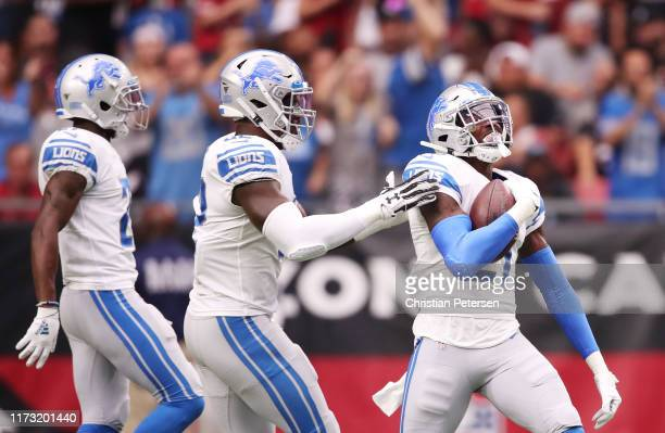 Defensive back Tracy Walker of the Detroit Lions celebrates his interception in the first quarter of the game against the Arizona Cardinals at State...