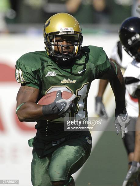 Defensive back Trae Williams of the University of South Florida Bulls rushes upfield with an interception against the Cincinnati Bearcats at Raymond...