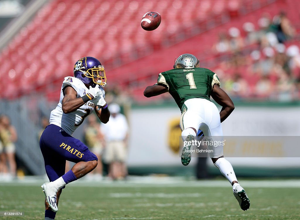 Defensive back Travon Simmons #3 of the East Carolina Pirates breaks up a pass intended for wide receiver Chris Barr #1 of the South Florida Bulls during the 3rd quarter at Raymond James Stadium on October 8, 2016 in Tampa, Florida.