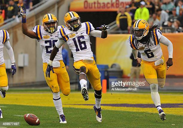 Defensive back Tre'Davious White of the LSU Tigers celebrates with Craig Loston after intercepting a first half pass against the Iowa Hawkeyes...
