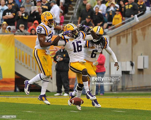 Defensive back Tre'Davious White of the LSU Tigers celebrates with teammates Rickey Jefferson and Craig Loston after intercepting a firsthalf pass...