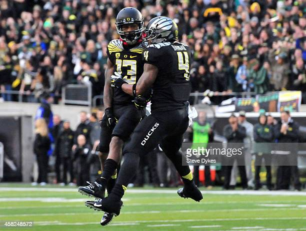 Defensive back Troy Hill and defensive back Erick Dargan of the Oregon Ducks celebrate during the first half of the game against the Stanford...