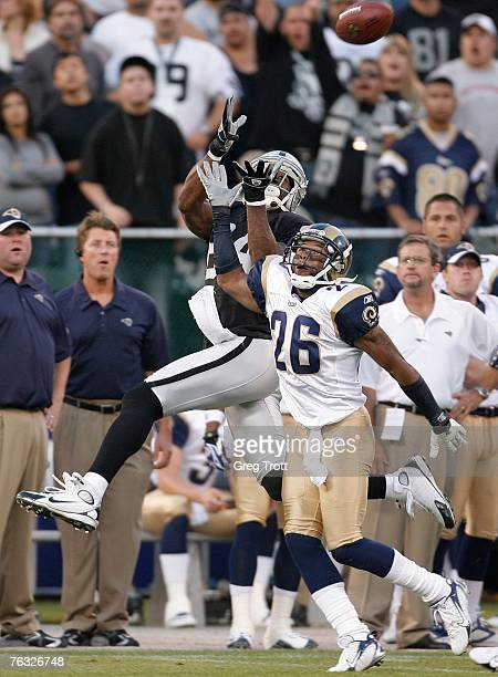 Defensive back Tye Hill of the St Louis Rams is called for pass interference against wide receiver Jerry Porter of the Oakland Raiders during a...