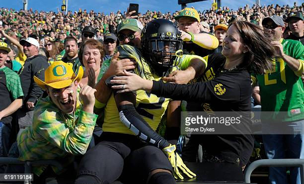 defensive back Tyree Robinson of the Oregon Ducks dives into the crowd before the game against the Arizona State Sun Devilsat Autzen Stadium on...