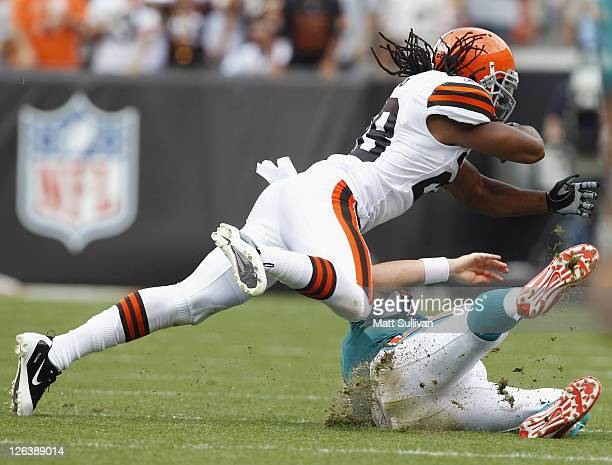 Defensive back Usama Young of the Cleveland Browns hits quarterback Chad Henne of the Miami Dolphins at Cleveland Browns Stadium on September 25 2011...