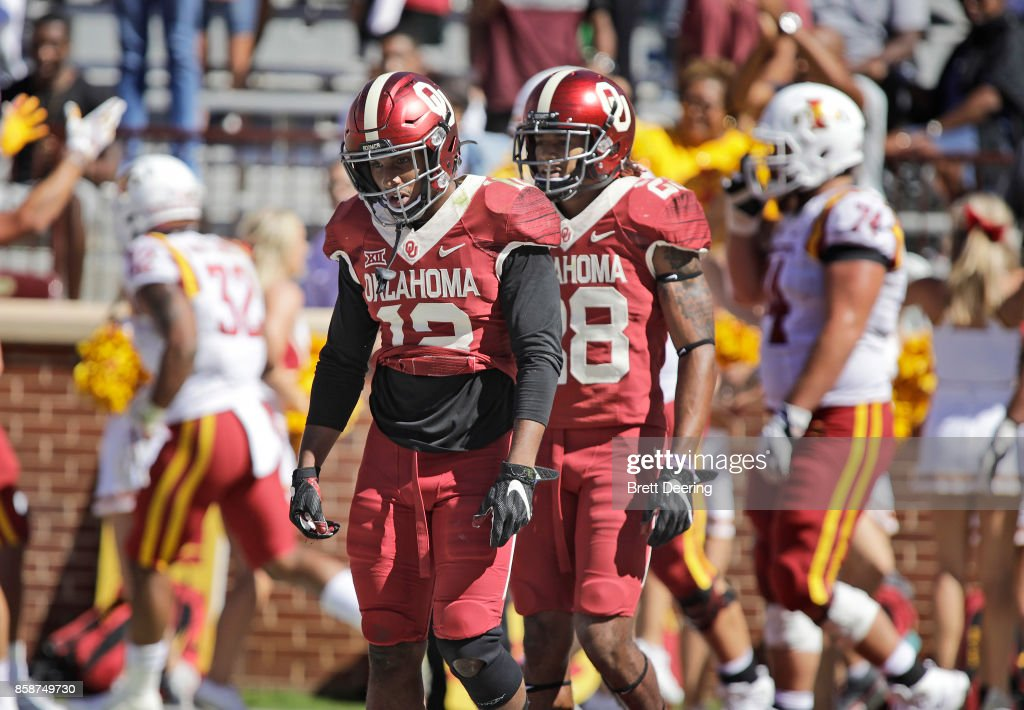 Defensive back Will Johnson #12 and safety Chanse Sylvie #28 of the Oklahoma Sooners walk away after the Iowa State Cyclones scored their last touchdown at Gaylord Family Oklahoma Memorial Stadium on October 7, 2017 in Norman, Oklahoma. Iowa State defeated Oklahoma 38-31.