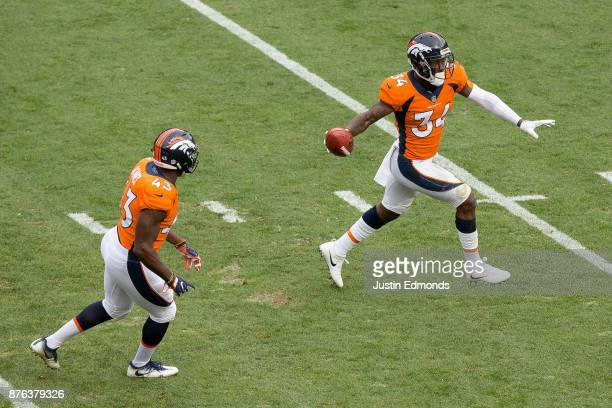 Defensive back Will Parks of the Denver Broncos celebrates after recovering a blocked punt in the first quarter of a game against the Cincinnati...