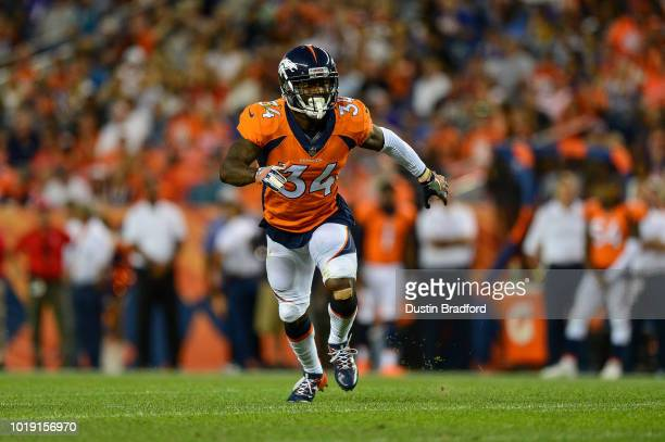 Defensive back Will Parks of the Denver Broncos defends against the Minnesota Vikings during an NFL preseason game at Broncos Stadium at Mile High on...