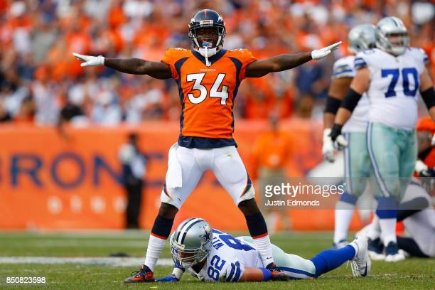 Defensive back Will Parks of the Denver Broncos reacts after defending a pass intended for Tight end Jason Witten of the Dallas Cowboys at Sports...