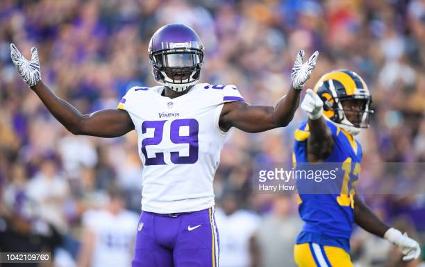 Defensive back Xavier Rhodes of the Minnesota Vikings reacts to his holding penalty in front of wide receiver Brandin Cooks of the Los Angeles Rams...