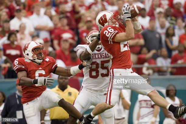 Defensive back Zach Hampton of the Wisconsin Badgers intercepts a pass during a game against the Arkansas Razorbacks in the Capital One Bowl at the...