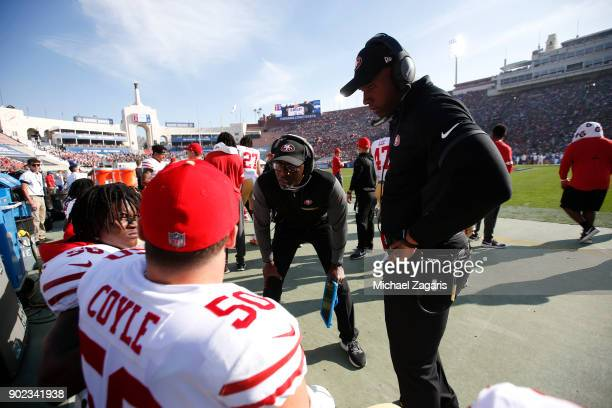Defensive Backs Coach Jeff Hafley of the San Francisco 49ers talks with Reuben Foster and Brock Coyle on the sideline during the game against the Los...