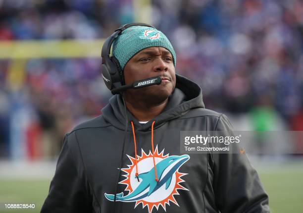 Defensive backs coach Tony Oden of the Miami Dolphins looks on from the sideline during NFL game action against the Buffalo Bills at New Era Field on...