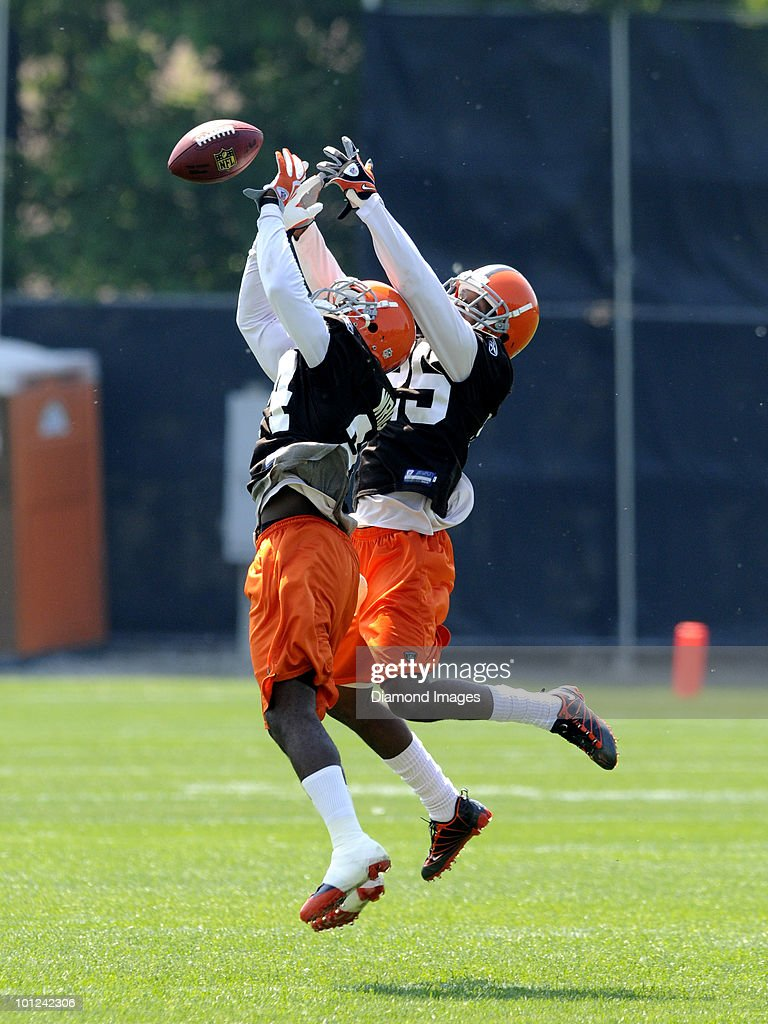 Defensive backs Eric Wright #24 and Coye Francies #25 of the Cleveland Browns battle for a pass during the team's organized team activity (OTA) on May 27, 2010 at the Cleveland Browns practice facility in Berea, Ohio.