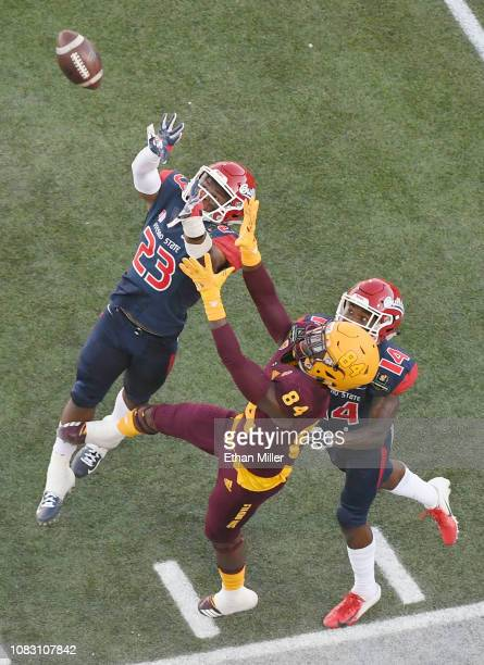 Defensive backs Juju Hughes and Jaron Bryant of the Fresno State Bulldogs break up a pass intended for Frank Darby of the Arizona State Sun Devils...