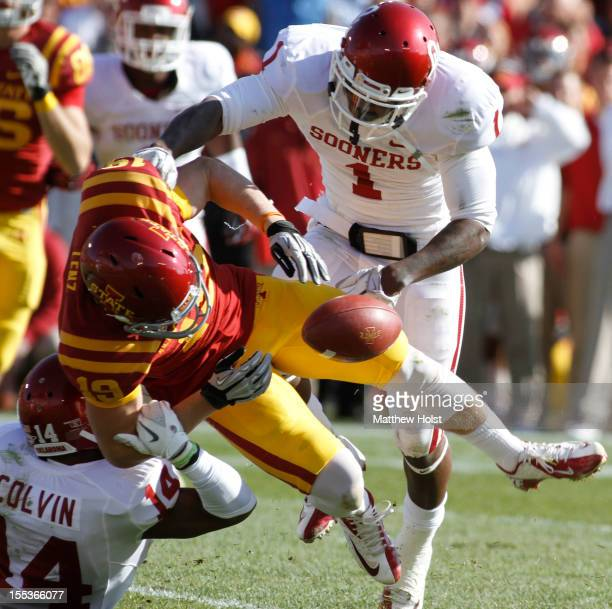 Defensive backs Tony Jefferson and Aaron Colvin of the Oklahoma Sooners break up a pass during the fourth quarter intended for wide receiver Josh...