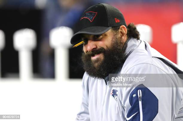 Defensive Coodinator Matt Patricia of the New England Patriots looks on before the AFC Divisional Playoff game against the Tennessee Titans at...