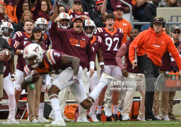 Defensive coordinator Bud Foster of the Virginia Tech Hokies reacts following an interception by cornerback Greg Stroman against the Pittsburgh...