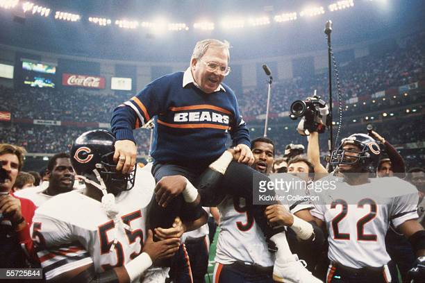 Defensive coordinator Buddy Ryan is held aloft by members of his defense including Otis Wilson Richard Dent and Dave Duerson of the Chicago Bears...