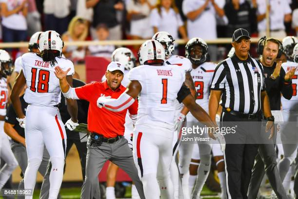 Defensive Coordinator David Gibbs reacts to play on the field with Jordyn Brooks of the Texas Tech Red Raiders during the game on September 16 2017...