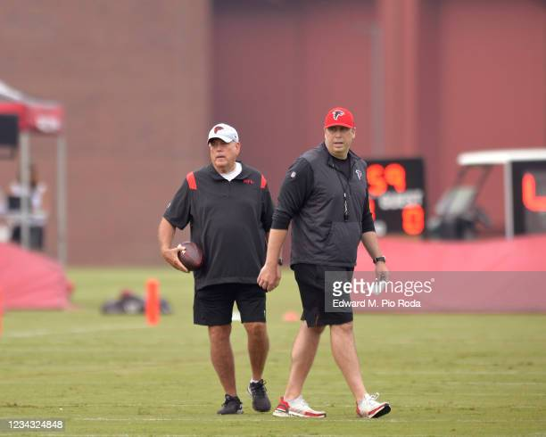 Defensive Coordinator Dean Pees of the Atlanta Falcons stands with Head Coach Arthur Smith during training camp at IBM Performance Field on July 30,...