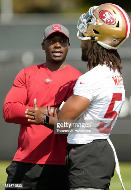 Defensive Coordinator DeMeco Ryans of the San Francisco 49ers talks with linebacker Fred Warner during training camp at SAP Performance Facility on...