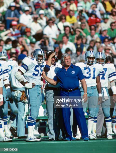 Defensive coordinator Ernie Stautner of the Dallas Cowboys stands with linebacker Gary Brown as cornerback Bennie Barnes looks on during a game...