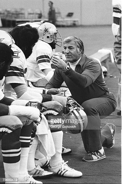 Defensive coordinator Ernie Stautner of the Dallas Cowboys talks with players during a game against the Pittsburgh Steelers at Three Rivers Stadium...