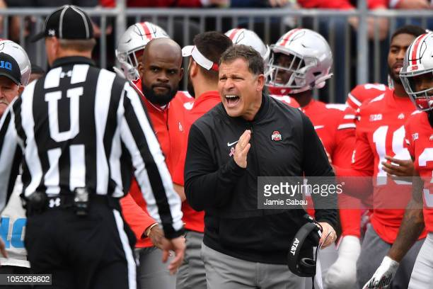 Defensive Coordinator Greg Schiano of the Ohio State Buckeyes pleads a call with the umpire in the second quarter against the Minnesota Gophers at...