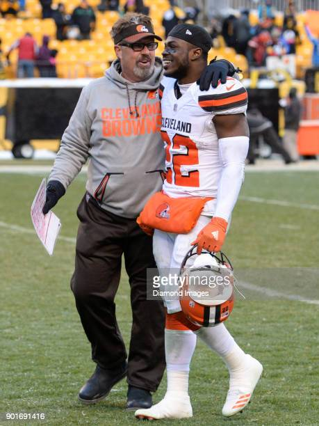 Defensive coordinator Gregg Williams and safety Jabrill Peppers of the Cleveland Browns converse as they walk off the field after a game on December...