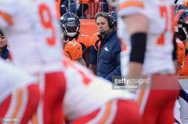 Defensive Coordinator Jack Del Rio of the Denver Broncos watches the Kansas City Chiefs offense during the game at Sports Authority Field at Mile...