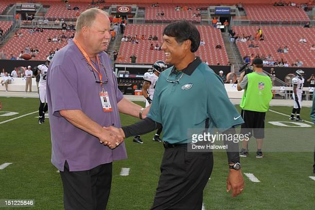 Defensive coordinator Juan Castillo of the Philadelphia Eagles and president Mike Holmgren of the Cleveland Browns talk at Cleveland Browns Stadium...