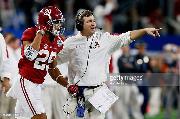 Defensive coordinator Kirby Smart directs Minkah Fitzpatrick of the Alabama Crimson Tide on the sideline in the fourth quarter while taking on the...