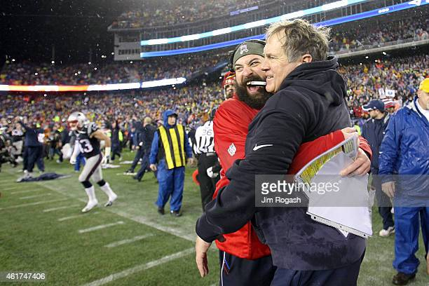 Defensive Coordinator Matt Patricia and head coach Bill Belichick of the New England Patriots celebrate after defeating the Indianapolis Colts in the...