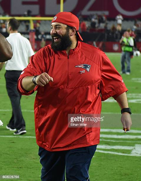 Defensive coordinator Matt Patricia of the New England Patriots smiles as he runs off the field after the team's 2321 victory over the Arizona...