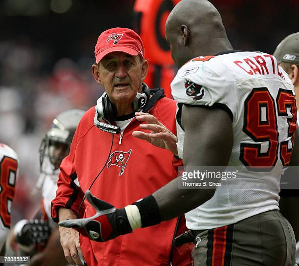 Defensive coordinator Monte Kiffin of the Tampa Bay Buccaneers coaches Kevin Carter during the NFL game against of the Houston Texans at Reliant...
