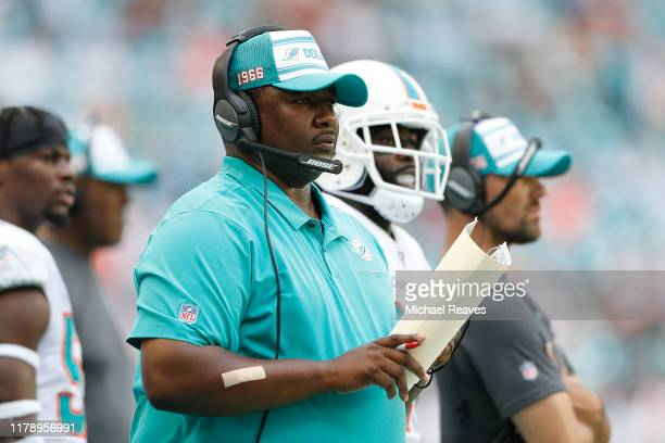 Defensive coordinator Patrick Graham looks on against the Los Angeles Chargers during the second quarter at Hard Rock Stadium on September 29 2019 in...