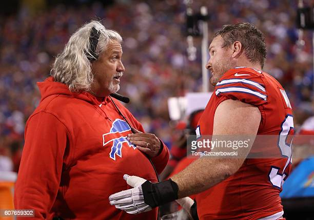 Defensive coordinator Rob Ryan of the Buffalo Bills talks to Kyle Williams on the sideline during NFL game action against the New York Jets at New...