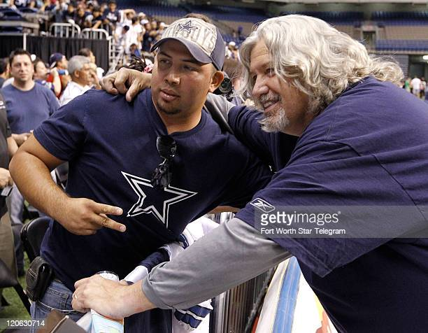 Defensive Coordinator Rob Ryan right has his picture taken with fan Julio Vega of San Antonio after the Dallas Cowboys blue/white scrimmage at the...