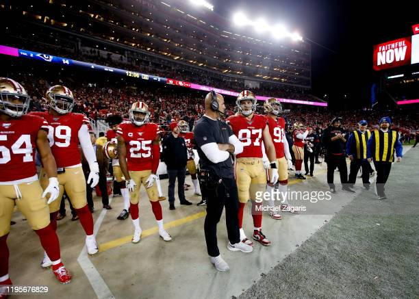 Defensive Coordinator Robert Saleh ahd Nick Bosa of the San Francisco 49ers talk on the sideline during the game against the Los Angeles Rams at...