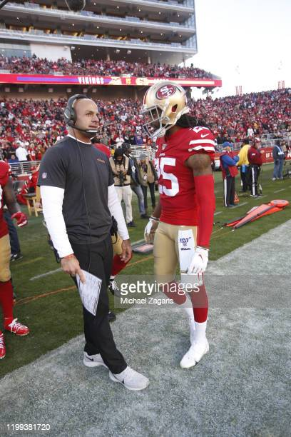 Defensive Coordinator Robert Saleh and Richard Sherman of the San Francisco 49ers talk on the sideline during the game against the Minnesota Vikings...
