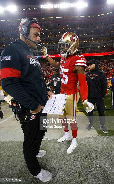 Defensive Coordinator Robert Saleh and Richard Sherman of the San Francisco 49ers talk on the sideline during the game against the Green Bay Packers...