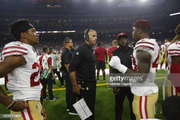Defensive Coordinator Robert Saleh of the San Francisco 49ers talks with players on the sideline during the game against the Houston Texans at NRG...