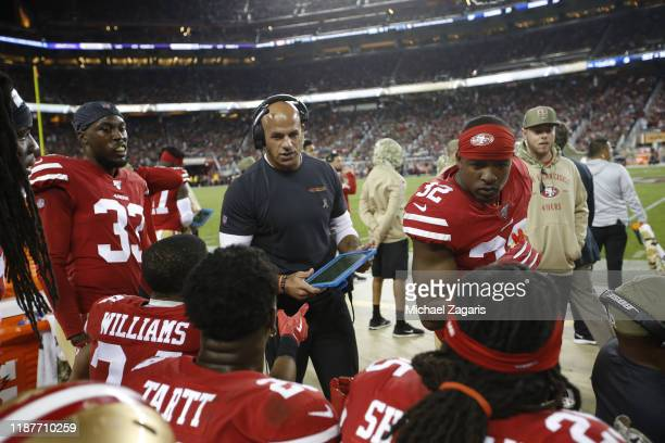Defensive Coordinator Robert Saleh of the San Francisco 49ers talks with the defensive backs on the sideline during the game against the Seattle...