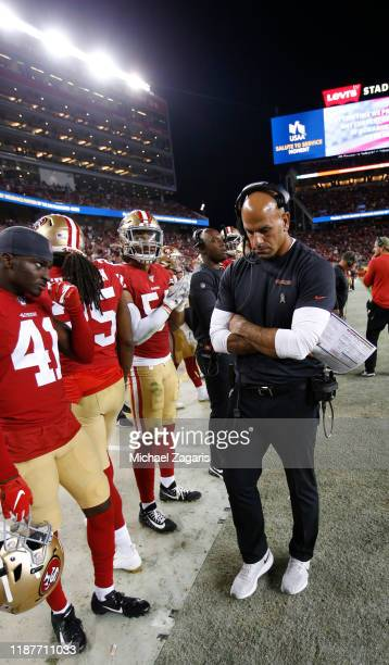 Defensive Coordinator Robert Saleh of the San Francisco 49ers talks with the defense on the sideline during the game against the Seattle Seahawks at...