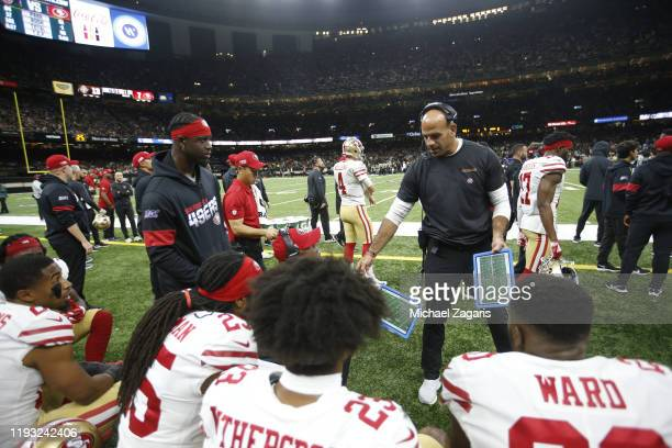 Defensive Coordinator Robert Saleh of the San Francisco 49ers talks with the defense on the sideline during the game against the New Orleans Saints...
